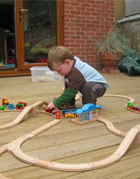 Child playing on decking