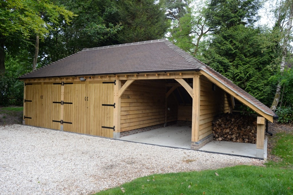 3 bay oak framed garage with logstore
